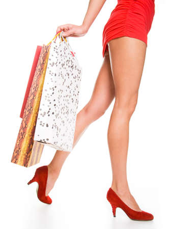 Waist-down view of woman carrying shopping bags Stock Photo - 6791534