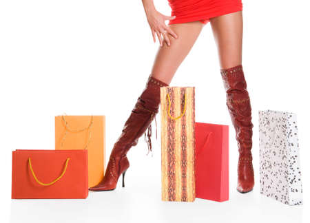 The sexual woman standing among multi-coloured bags with purchases Stock Photo - 6791533