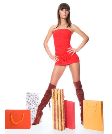 The sexual woman standing among multi-coloured bags with purchases Stock Photo - 6782496