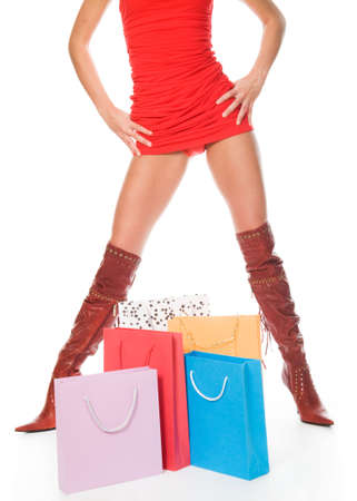 The sexual woman standing among multi-coloured bags with purchases Stock Photo - 6791535