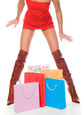 The sexual woman standing among multi-coloured bags with purchases Stock Photo - 6791538