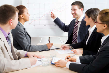 Modern young people at a business meeting Stock Photo - 6782521