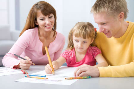 Portrait of little girl painting something and her father and mother  Stock Photo - 6866564