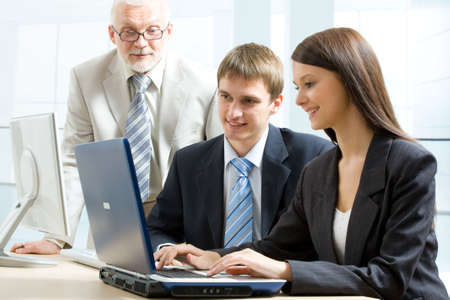 Three business people working in an office Stock Photo - 6866617