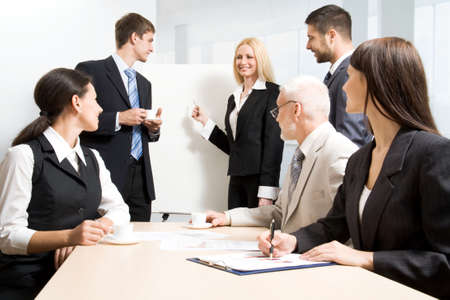 solicitor: Group of business people discussing  the results of their work