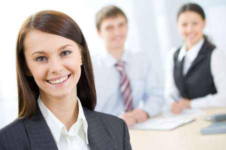 Business people working. Focus is on the woman in front Stock Photo - 6866603