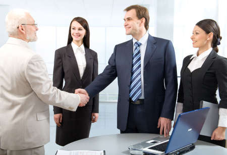 Delegation: Business colleagues shaking hands Stock Photo