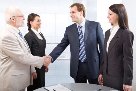 Business colleagues shaking hands photo