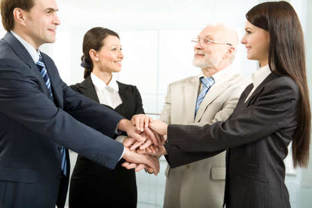 incentives: Business people joining their hands Stock Photo