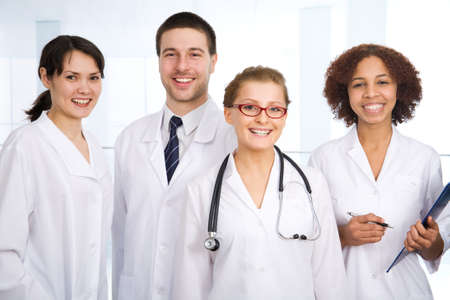 female doctor: Doctor stays in front of her team Stock Photo