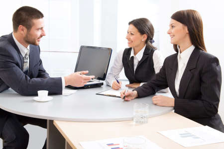 Three businesspeople discussing photo