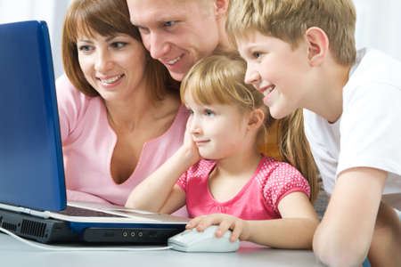 Happy family with the laptop photo