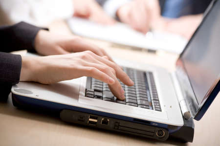 Business woman uses the laptop. Close-up. Focus is on her hands Stock Photo - 9265151