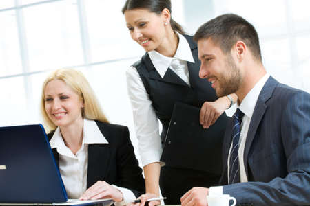 Three business people working in team photo
