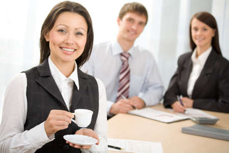 Businesswoman with a coffee cup in the office photo