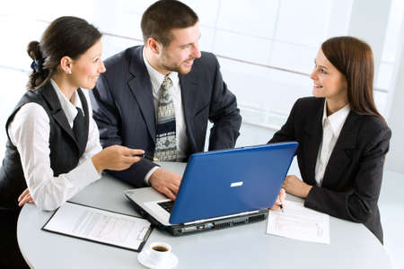 Three successful colleagues working  in the office Stock Photo - 9265172