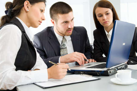 Working  businesspeople in an office Stock Photo - 9265167