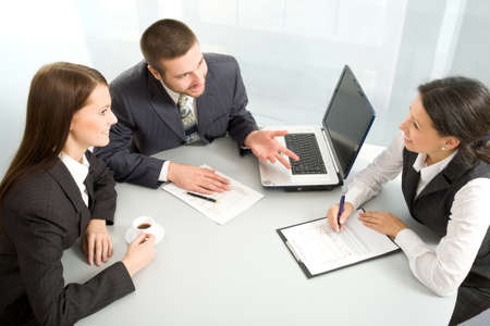 business insurance: Three business people creating a business plan Stock Photo