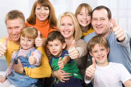 prosperous: A portrait of a large prosperous family with their thumbs up
