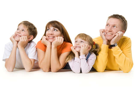 Harmonious family laying down and looking up Stock Photo - 9265142