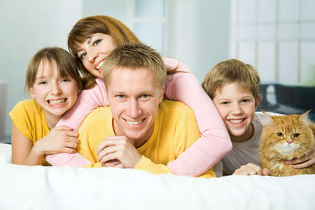 Family of four and a cat playing the fool Stock Photo - 9265184