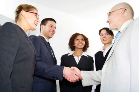 politeness: Business people shaking hands