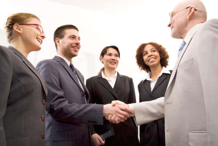 to deal with: Business people shaking hands