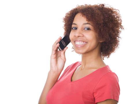 Beautiful teenage girl talking on cell phone photo