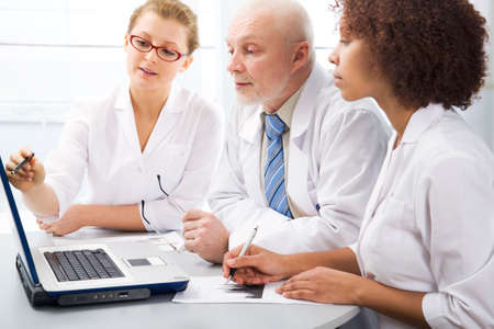 Group of doctors discuss work photo