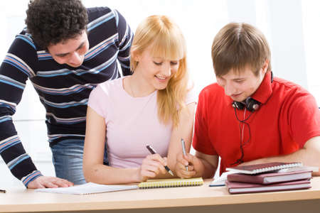 studygroup: Portrait of a young group of students paying attention in class Stock Photo