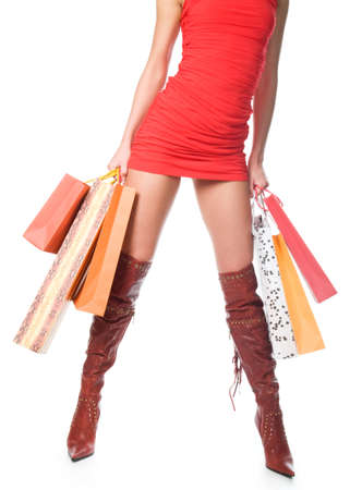 Waist-down view of woman carrying shopping bags Stock Photo - 9335555