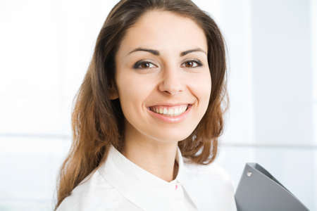 A portrait of a young business woman in an office Stock Photo - 9334986
