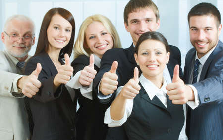 Cheerful business people showing that everything is OK photo