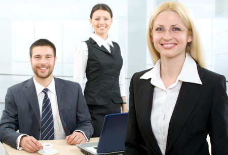 writing activity: Portrait of a businesswoman and people on the background Stock Photo