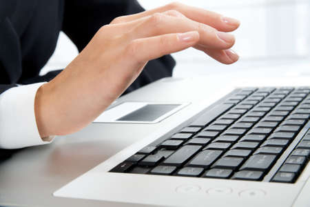 alphabet computer keyboard: Woman�s hand working on the laptop