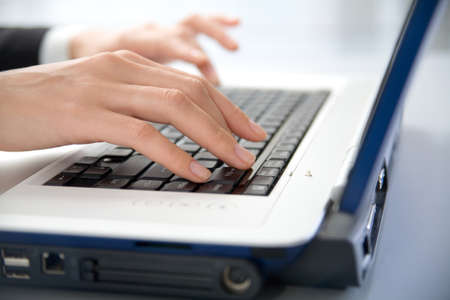 Photo of female hands typing a letter on the laptop Stock Photo - 9335579