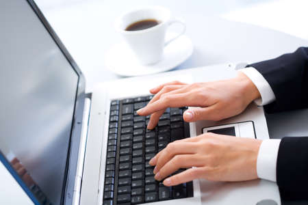 Image of human hands doing some computer work photo
