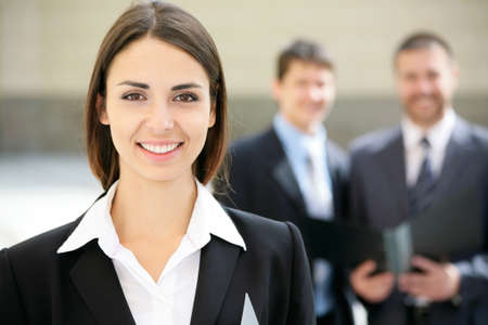 Beautiful businesswoman on the background of business people  photo