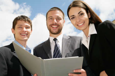 Young and successful businessteam standing in a corridoor of a modern office  photo