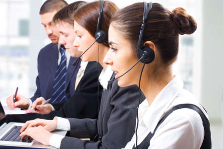 contact center: A friendly secretarytelephone operator in an office environment.