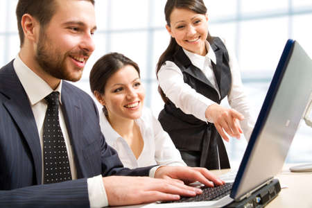 technology to communicate: Business team at a meeting in a  modern office environment