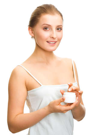 moisturiser: Young adult girl applying moisturiser cream. Healthcare concept. Stock Photo