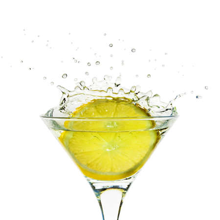 coctail: Glass with juice and lemon splashing on the white background
