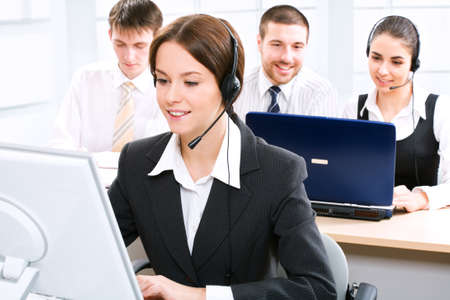 A friendly secretarytelephone operator in an office environment. photo