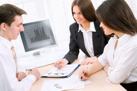 Image of successful partners discussing business plan at meeting photo
