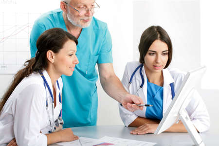 Medical theme: doctors are studying a medical report photo