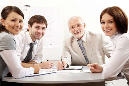 Business people working in an office photo