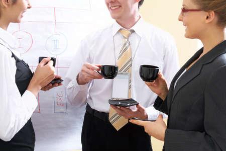 Successful businessmen talk at a seminar during a break photo