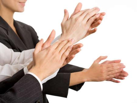 aplaudiendo: Aplaudan a manos de personas de negocios. El cierre hasta Foto de archivo