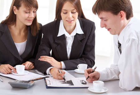 Young businesswoman showing chart his colleagues photo